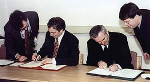 Tony Blair and Bertie Ahern sign the Good Friday Agreement in 1998
