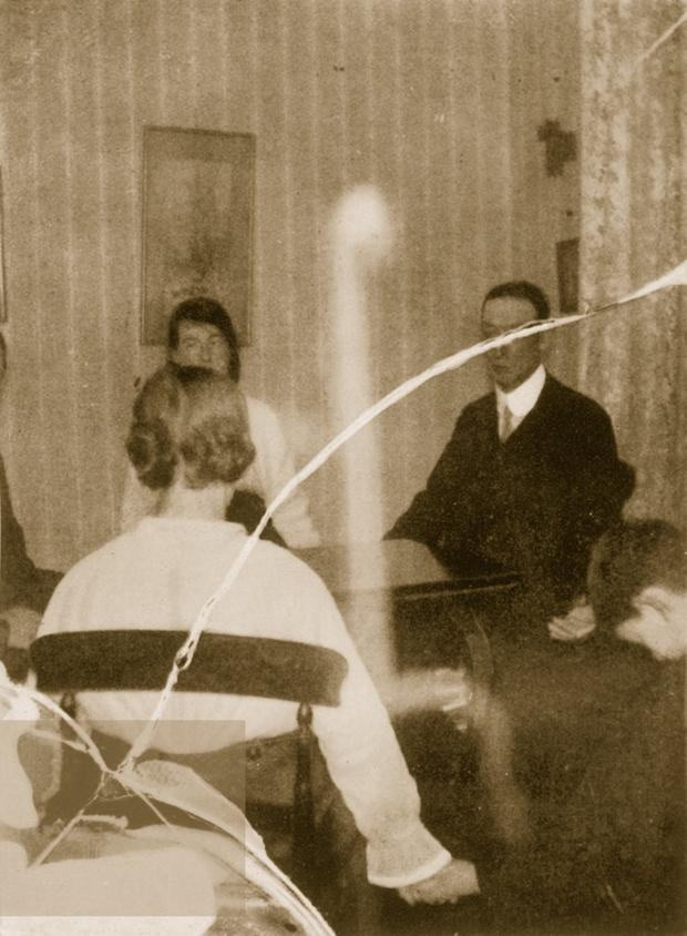 The 'Goligher Circle' with Kathleen Goligher and what Dr Crawford believed to be ectoplasm exuding from her body, but which was later dismissed as a trick using muslin cloth
