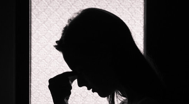 Troubles legacy: people who witnessed violence or have been involved in violence are more likely to act on suicidal thoughts. File image posed by model