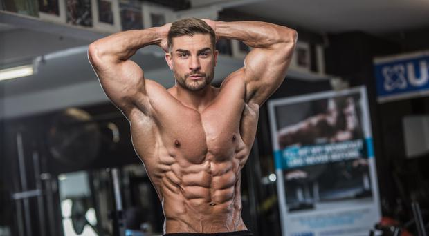 Ryan Terry flexes his muscles