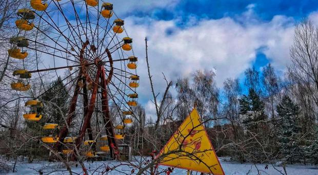 Nuclear chill: the yellow cabins of the Ferris wheel at Chernobyl's unused fairground stand mute witness to the horrors of the explosion