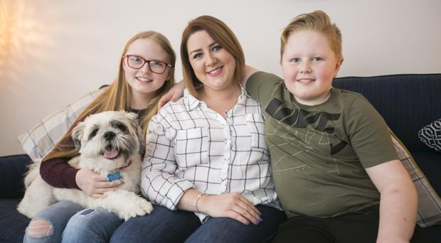 Staying strong: Belfast mum Lisa Hewitt with her children Sophie and Kyle and their dog Ted