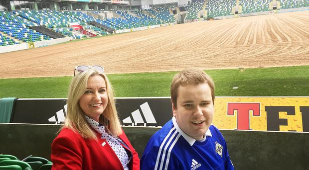 Pitch perfect: Mark Dobson with mum Jo-Anne at Windsor Park