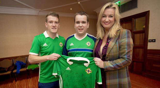 Big match: NI captain Steven Davis with Mark and Jo-Anne Dobson last year