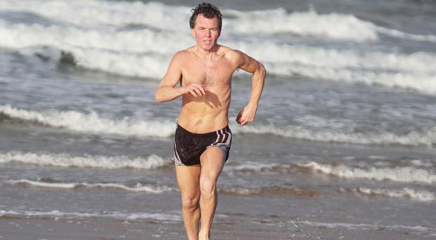 Marathon man: Peter Ferris goes for a more relaxed run down by the sea