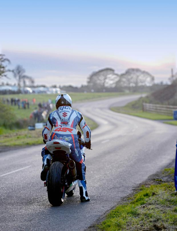 2014: (Left) The day was drawing to a close as William sat on the start line during practice on his Tyco Suzuki at the 2014 Tandragee 100. Only the winding road lies in wait