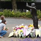 Sympathies are paid at the Dunlop Memorial garden yesterday