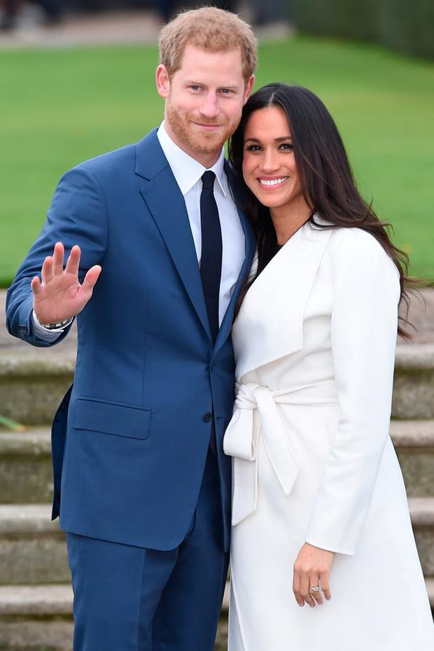 Meghan with Prince Harry in the Sunken Garden of Kensington Palace after announcing their engagement