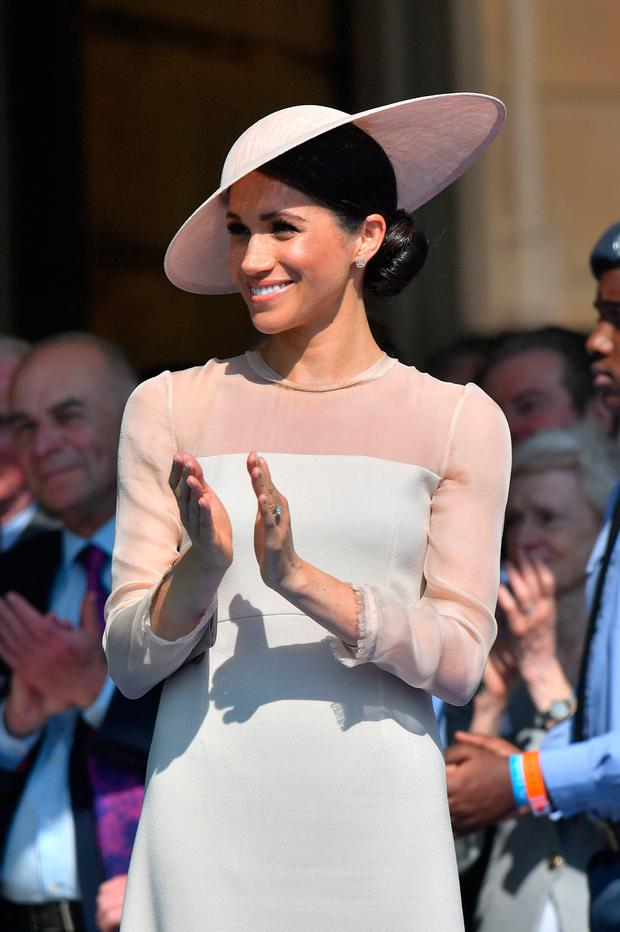Meghan attending a garden party at Buckingham Palace