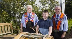 Three generations of Walkers — Tommy, Thomas and Mervyn — from Loughgall getting ready for the Twelfth