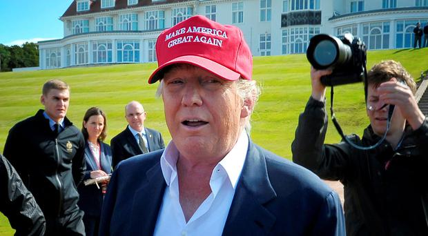 Great Scot: US President Donald Trump is a hit with those living near his luxury Scots golf resort