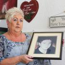 Valuable work: Sadie O'Reilly holds a photograph of her son Tony, whose death from a heroin overdose motivated her to set up the charity HURT
