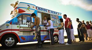 Fab times: People queueing in front of an ice cream van to enjoy a cone...or two