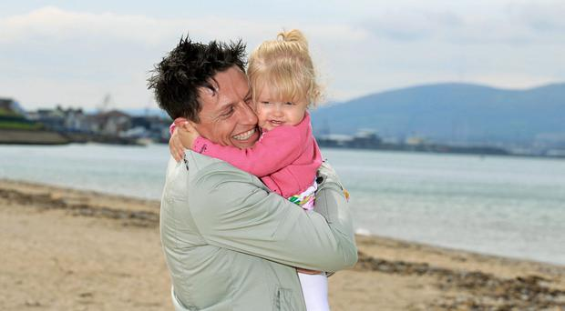 Beach life: Stephen Clements, with his daughter Poppy, has fond memories of Barry's in Portrush