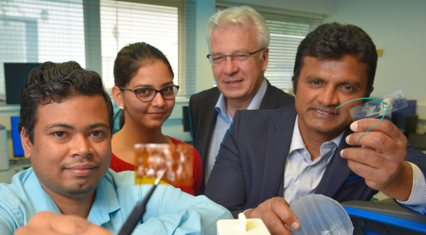 Ulster University researchers Gowrav Battacharya, Anukriti Singh and Puttaswamy Srinivasu with NIBEC director Professor James McLaughlin (second right)