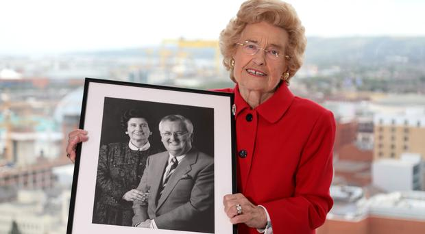 Lady Joy Hastings holds a photograph of her late husband Sir William at the Grand Central Hotel