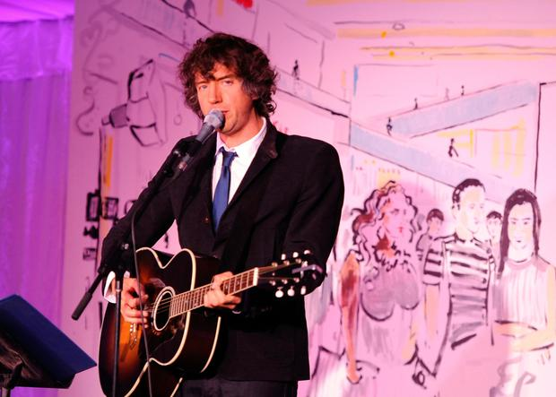 Gary Lightbody performing on stage