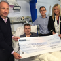 Massive appreciation: Mark Dobson and his mum Jo-Anne presenting a cheque for £510 to the Renal Unit at Daisy Hill Hospital in February, with BBC sports presenter Stephen Watson, consultant nephrologist Dr Neal Morgan and ward sister Kay Donegan