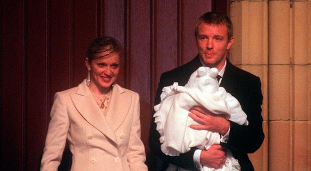 Enduring superstar: Madonna with ex-husband Guy Ritchie and their son Rocco in 2000