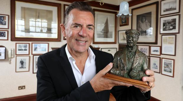 TV presenter Duncan Bannatyne with a bust of Sir Thomas Lipton during filming in Bangor