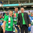 Big game: Mark Dobson at his first post-transplant football match watching Northern Ireland v Bosnia with his cousin Alex and grandad Eric