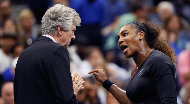 Serena Williams remonstrates with referee Brian Earley during the final of the US Open