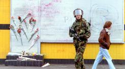 Notorious atrocity: a soldier outside Sean Graham's on the Ormeau Road, where five men were murdered