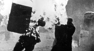The terrifying image of RUC officer Alan Brown during a riot in the Bogside in Londonderry