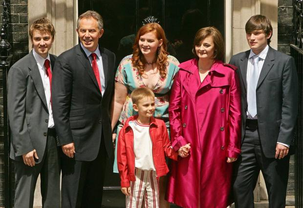 Euan (far left) with Tony, sister Kathryn, brother Leo, mum Cherie and brother Nicky after the family left Downing Street for the last time in 2007