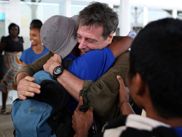 The emotional writer hugs a sailor who was one of the hostages