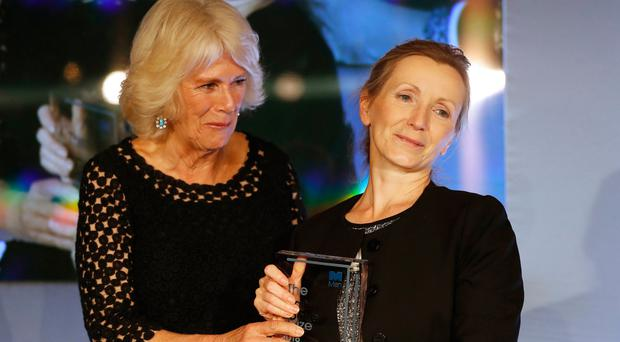Huge achievement: The Duchess of Cornwall (left) presents the Man Booker Prize for Fiction to Anna Burns at the Guildhall in London