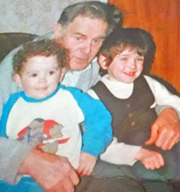 Changed days: a childhood picture of Joanne with her cousin and her grandad