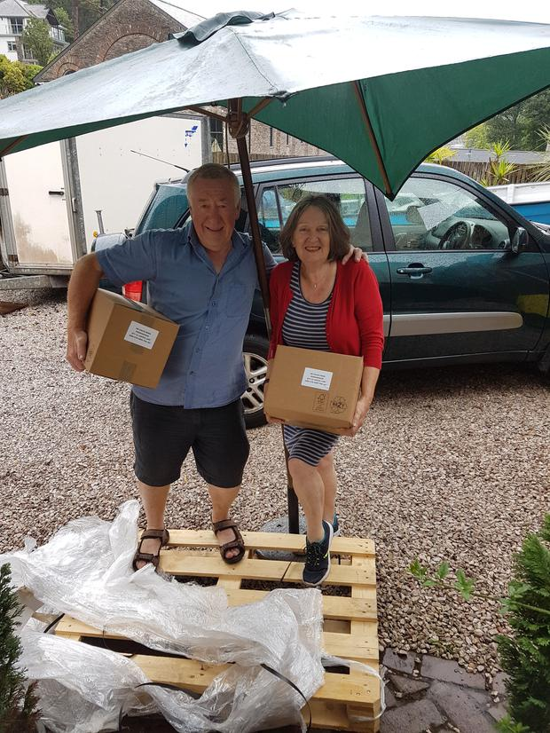 Catherine with husband David taking delivery of copies of first book Moonmirror