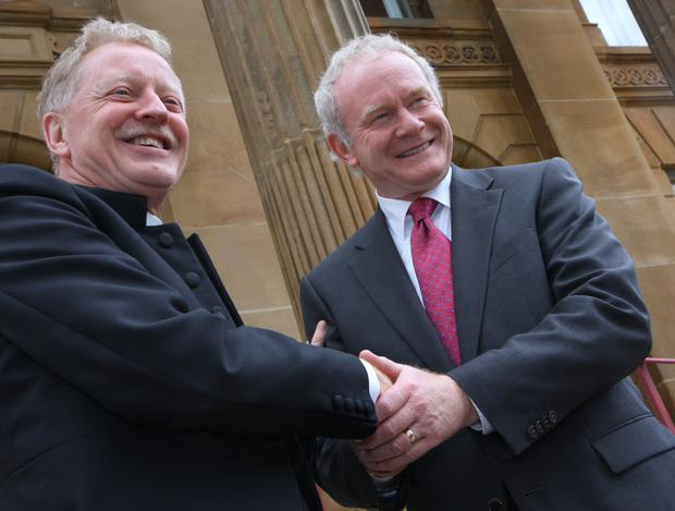 Symbolic handshake: Rev Dr David Latimer welcomes the then Deputy First Minister Martin McGuinness to First Derry Presbyterian Church