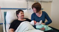 New life: Ruth Davidson and partner Jen Wilson with baby boy Finn
