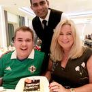 Lovely touch: Mark, Jo-Anne and waiter Nikhil with their cake on the cruise ship
