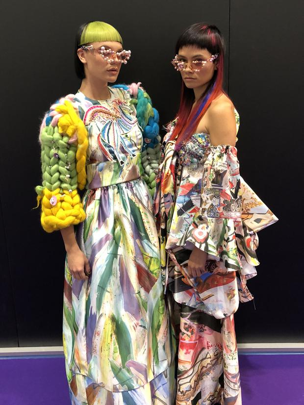 Models wearing outfits designed by Hope