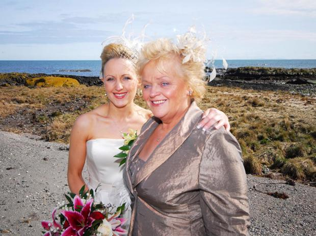 Proud parent: Rebekah with her mother Roberta on her wedding day