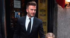 Controversy: David Beckham with his daughter, Harper