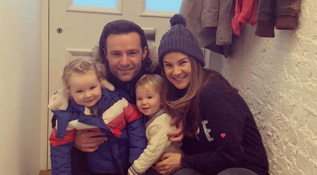 Happy family: Izzy and Harry Judd with their children, Kit and Lola