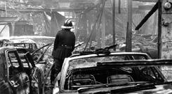 Gruesome scene: a firefighter a at the scene of an explosion during Bloody Friday