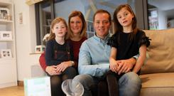 Blue sky thinking: pilot Ryan Phillips, wife Julie-Ann and daughters Autumn (7) and Florence (5)