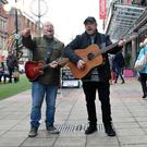 Surprise performance: Eddie and George Furey busking in Belfast