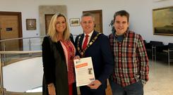 Charity champion: Paul Michael (centre), Antrim and Newtownabbey Mayor, gets a thank-you certificate from Mark Dobson and mum Jo-Anne