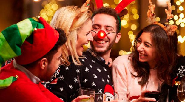 Christmas cheers: people toasting the festivities with a drink or two