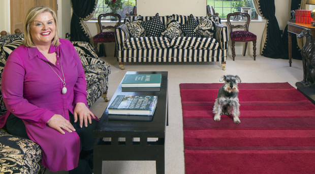 Home comforts: Joyce with miniature schnauzer Murphy in the living room of her home