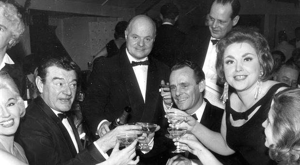 Cyril Lord (centre) entertains actor Jack Hawkins (left) and wife Doreen (far right)