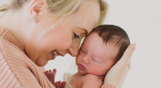 Family bond: Sarah Bryden with her son Evan when he was born