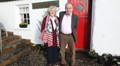 Creighton and Pearl Hutchinson in front of the restored Rosie's Cottage