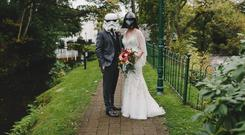 The couple in Star Wars helmets